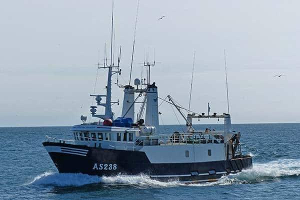 Danish trawler lost, crew rescued