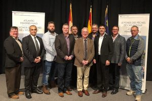 Representatives of the companies receiving funding with New Brunswick Deputy Premier Robert Gauvin