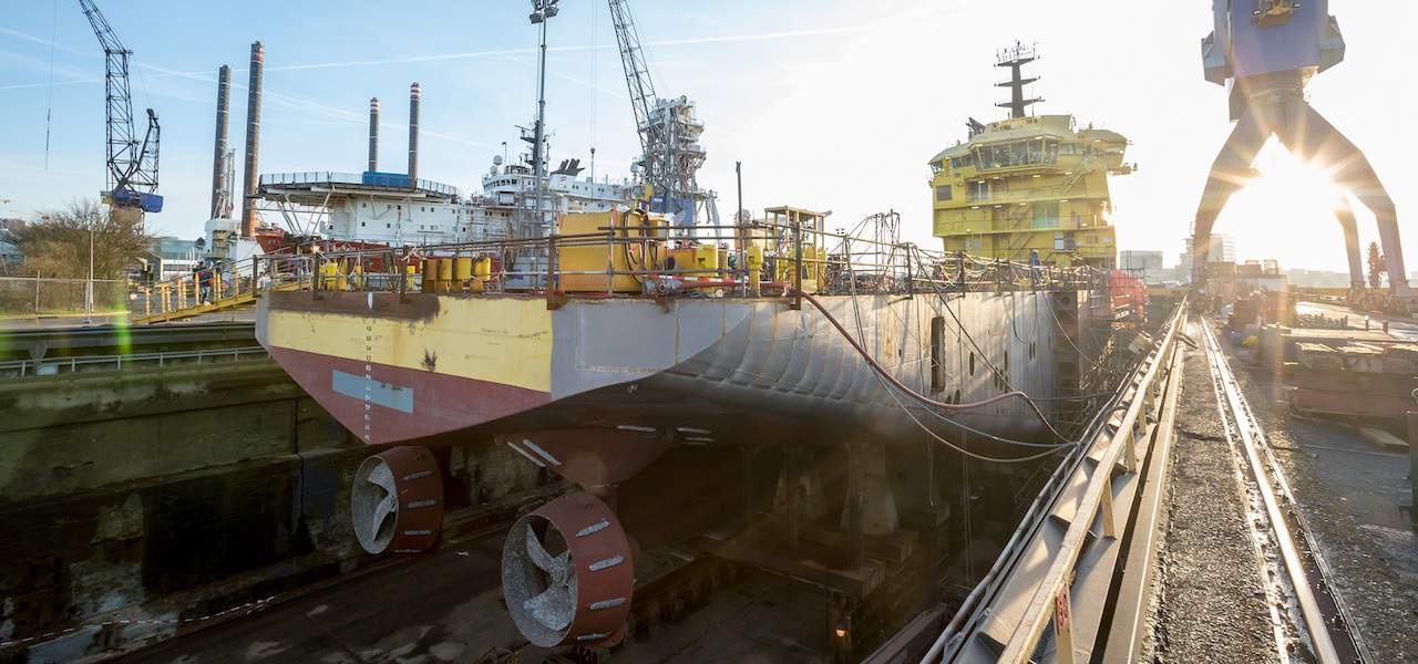 Platform supply vessel  converted to fish feed carrier