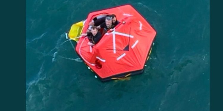 Cruise passengers tweeted images of some of Sonja's crew being rescued from a liferaft. Image: Twitter - @ Fiskerforum