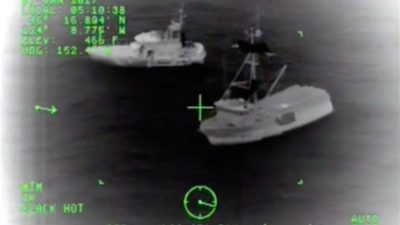 USCG and fishing crew rescue five